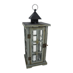 Rustic Distressed Finish Gray Lantern Candle Holder - This beautiful metal, resin and glass decorative lantern style candle holder has a wonderfully rustic, distressed gray enamel finish . The lantern features an antiqued brass opener on the door, and has a heat resistant silvered plate on the bottom for safety. It has a hanger ring on top, so you can hang it from eaves or trees, and has a flat bottom, so it can be displayed on tables or decks. The lantern is 14 1/2 inches tall (15 1/2 inches including the hanger), 5 3/4 inches wide and 5 3/4 inches deep. It can accept pillar candles up to 3 inches in diameter and 7 inches tall. It makes a great gift for friends and family.