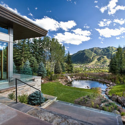 Aluminum Clad Windows and Doors - Aspen residence features large expanse glass aluminum clad windows.  Photo credit Mike Hefron.