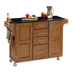 Home Styles - Home Styles Furniture Black Granite Kitchen Cart in Cottage Oak Wood - Home Styles - Kitchen Carts - 91001064 - The freedom to conduct food preparation anywhere you wish sums up the entire appeal of the Home Styles Kitchen Cart. Whatever the task entails this cart is more than up to it with an easy-clean granite counter top four utensil / storage drawers and two interior cabinets with adjustable shelving. Four wheel casters allow for freedom of movement and feature a locking function for safety. Side mounted spice and towel racks add further practicality while a cottage oak finish provides an inherent warmth.