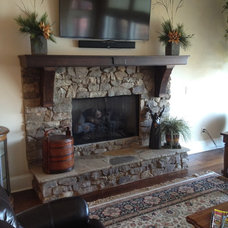 Traditional Fireplaces by Total Quality Home Builders, Inc.