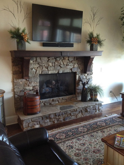 Traditional Indoor Fireplaces by Total Quality Home Builders, Inc.