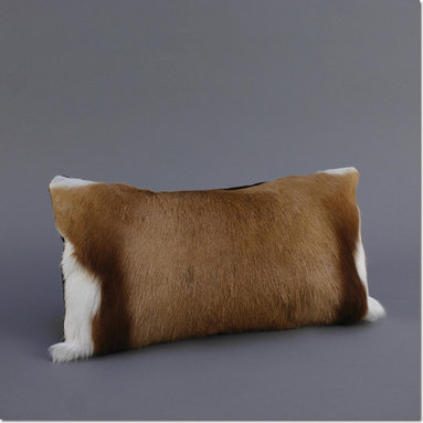 Springbok Pillow - Classic pillow in Springbok hide from Africa with a brown velvet back. The cases are filled with feather and down inserts, which create a naturally firm, yet soft cushion. As importantly, the inserts are filled to a medium weight, allowing the pillow to plump nicely, while never appearing overstuffed.