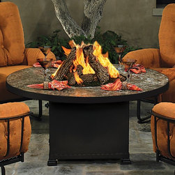 O W Lee Company Inc - O.W Lee Casual Fireside Vesuvius Round Fire Pit Table - 51-03A-SP11-P-54PITS-51- - Shop for Fire Pits and Fireplaces from Hayneedle.com! There's no need to explain the appeal of gathering around a roaring fireplace so adding the O.W. Lee Casual Fireside Vesuvius Round Fire Pit Table to your patio or poolside should be just as cozy right? It might actually be more pleasant but we'll let you be the judge of that. First you'll need to pick your favorite finish for the wrought iron frame. When you've got a finish take advantage of the wide range of table top styles and sizes. You can choose from metal tile and slate and there's an equally impressive selection of materials to fill your fire-pit. Once you've fully customized your fire pit find the perfect spot outdoors and just wait for you family and friends to leave that indoor fireplace and join you outside. Runs on propane and/or natural gas conversion kit for natural gas is included. Materials and construction:Only the highest quality materials are used in the production of O.W. Lee Company's furniture. Carbon steel galvanized steel and 6061 alloy aluminum is meticulously chosen for superior strength as well as rust and corrosion resistance. All materials are individually measured and precision cut to ensure a smooth and accurate fit. Steel and aluminum pieces are bent into perfect shapes then hand-forged with a hammer and anvil a process unchanged since blacksmiths in the middle ages. For the optimum strength of each piece a full-circumference weld is applied wherever metal components intersect. This type of weld works to eliminate the possibility of moisture making its way into tube interiors or in a crevasse. The full-circumference weld guards against rust and corrosion. Finally all welds are ground and sanded to create a seamless transition from one component to another. Each frame is blasted with tiny steel particles to remove dirt and oil from the manufacturing process which is then follow