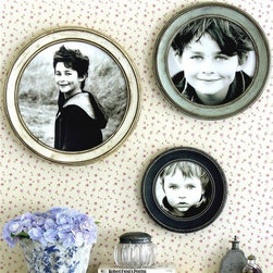Obrien Schridde Nostalgic Frames - Reminiscent of a ship's porthole, the playful shape of the round Nostalgic frame contrasts its traditional design. Group multiple sizes or styles together for an eye-catching look in a living room, bedroom or foyer. Environmentally friendly, these frames are made from recycled materials and made in USA. Photo credit: Obrien Schridde Designs