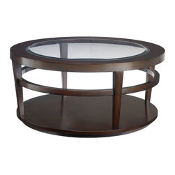 """Hammary - Hammary Urbana Glass Top Round Cocktail Table - Cocktail Table belongs to Urbana collection by Hammary If you're looking for furniture that is sleek and sophisticated; if you want to transform your home into a warmer and more welcoming place; if you hunger for a fresh start, a stylish renewal, a touch of originality - look no further than Hammary's striking new """"Urbana"""" collection. This group's alluring metro design features thin lines, canted legs, dark woods and Beveled glass inserts for a look that is both urban chic and suburban practical. Crafted from select hardwoods, cherry veneers and glass, """"Urbana"""" is certain to enhance any home setting. The dark Merlot finish contributes to the aura of quiet sophistication, and the oval rails add an extra level of class and complexity. This ingenious and yet simplistic design ensures that each piece will blend beautifully in any transitional living environment. Why settle for bland and commonplace when you can enliven your home with furniture that is both innovative and inspiring? """"Urbana"""" from Hammary. Making home feel more like home."""