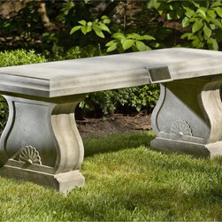 Campania International - Campania International Tribute Cast Stone Backless Garden Bench - BE-117-AL - Shop for Benches from Hayneedle.com! About Campania InternationalEstablished in 1984 Campania International's reputation has been built on quality original products and service. Originally selling terra cotta planters Campania soon began to research and develop the design and manufacture of cast stone garden planters and ornaments. Campania is also an importer and wholesaler of garden products including polyethylene terra cotta glazed pottery cast iron and fiberglass planters as well as classic garden structures fountains and cast resin statuary.Campania Cast Stone: The ProcessThe creation of Campania's cast stone pieces begins and ends by hand. From the creation of an original design making of a mold pouring the cast stone application of the patina to the final packing of an order the process is both technical and artistic. As many as 30 pairs of hands are involved in the creation of each Campania piece in a labor intensive 15 step process.The process begins either with the creation of an original copyrighted design by Campania's artisans or an antique original. Antique originals will often require some restoration work which is also done in-house by expert craftsmen. Campania's mold making department will then begin a multi-step process to create a production mold which will properly replicate the detail and texture of the original piece. Depending on its size and complexity a mold can take as long as three months to complete. Campania creates in excess of 700 molds per year.After a mold is completed it is moved to the production area where a team individually hand pours the liquid cast stone mixture into the mold and employs special techniques to remove air bubbles. Campania carefully monitors the PSI of every piece. PSI (pounds per square inch) measures the strength of every piece to ensure durability. The PSI of Campania pieces is currently engineered at appro