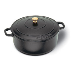 "Paderno World Cuisine - 8.625 Inch Black Round Dutch Oven - This Paderno World Cuisine 8.625 inch black round Dutch oven is primarily used to slowly braise or simmer. The ability of the Dutch oven to evenly distribute heat makes it perfect for tenderizing any cut of meat for stews or heavy cassoulets. These ovens are easy to clean, durable and compatible with standard stovetops, induction ranges, and conventional ovens. Each oven comes with a matching lid to keep in heat and moisture. The ""Chasseur"" cookware line has been enameled twice. It is first enameled in black, which seals the edges, protects against corrosion and is a primer for the color. Next it is enameled with a color, which adds durability and ensures that the oven retains its color. The enamel makes the oven easy to clean. All lid knobs are heat resistant up to 400 F. Note that all dimensions are interior and do not include handles or thickness of material.; Enameled twice; Lid knobs heat resistant up to 400 degrees. Sizes do not include handles.; Easy to clean; Durable and compatible with standard stovetops, induction ranges, and conventional ovens; Made in France; Weight: 9.3 lbs; Dimensions: 3.5""H x 8.63""L x 8.63""W"