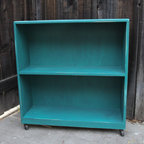 Turquoise Bookshelf with Castors by Other Sister Design - What started out as an ordinary, unassuming bookcase is now a whole lot of awesome! First, it's painted in a bright breath of turquoise. But turn it around (it's on casters for easy swiveling), and voilà — the back is painted with chalkboard paint for hours of fun.