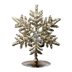 Snowflake Votive Holder Large - Bring some glitter to your table with this elegant, hand-beaded votive holder on an aged-bronze-finished metal stand. The sparkling snowflake captures the wonder of the season, and would look incredible lining your dining table — or adding some extra glow to the living room.