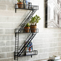 Book-Escape Wall Shelves - Wall art that doubles as storage? Sure, why not! Epoxy-coated steel has been welded by hand to create this hanging industrial shelving piece. Imitating the familiar form of a fire escape, some of its adjustable shelves can hang down like ladders while others display plants, books, pictures, and more.