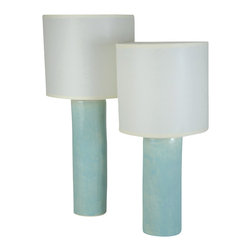 Small Cylinder Lamp - Handmade from stoneware clay and topped with a sleek, cream linen shade, this cylinder lamp is the perfect example of incredible craftsmanship. With this charming lamp on your side table or nightstand, you'll give your room a modern look with a personal touch.