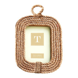 Know Your Ropes Photo Frame - Vertical - Loops of jute rope are bound together around the glass of the Know Your Ropes Photo Frame to form a continuous soft-cornered oblong. Loose fibers tightly bind the ropes at the bottom, balanced by the loop at the top which adds dimension and character to this seaside classic, a nautical 4x6 picture frame which also coordinates with any collection of natural fibers and hides.