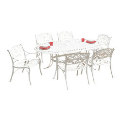 Home Styles - Home Styles Biscayne 7PC 72��_��_��_ Oval Dining Table Set - Home Styles - Patio Dining Sets - 5552338C - Biscayne 7PC Dining Set includes the Oval table and Six Arm Chairs with Sunbrella  Green Apple fabric Cushions. Home Styles cast aluminum outdoor dining collection gives you the beauty of ornately designed pieces without the high cost.  Constructed of cast aluminum in a UV resistant powder coated White Finish. The Oval Dining Table features a White Finish with a top that is designed specifically to prevent damage caused from pooling by allowing water to pass through freely.  Adjustable nylon glides prevent damage to surfaces caused by movement and provide stability on uneven surfaces. Size:  42w 72d 30h. Home Styles Arm Chair is constructed of cast aluminum with a White Finish. Features include powder coat finish sealed with a clear coat to protect finish and nylon glides on all legs. Chairs are packed two per carton. Item Size: 22.83w 21.65d 32.68h (Seat height 15.5H).  Stainless steel hardware.
