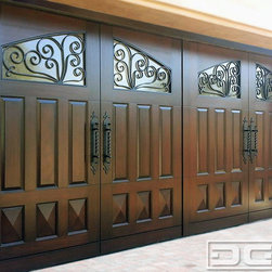 Dynamic Garage Door - Mediterranean Style Home in Laguna Niguel, CA | Dynamic Custom Wood Garage Doors - Mediterranean Garage Doors - this is a Laguna Niguel, CA complete home remodel. Dynamic Garage Door custom designed, manufactured and installed this beautiful Mediterranean Style Garage Door with gorgeous iron scrolling on the windows and hand-forged architectural handles. The raised panel design in the middle section and bottom diamond panels are made out of solid Mahogany wood. Dynamic Garage Door specializes in unique, one-of-a-kind architectural door designs that are highly acclaimed by many contractors, builders and homeowners. Each one of our Mediterranean Garage Door is uniquely designed and crafted per customer!