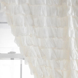 Waterfall Ruffle Curtain - I know I'm not the only one who's excited about ruffles being back in style—can you get any more feminine? These ruffled curtains from Urban Outfitters let soft light drift into a room, and add a perfectly sophisticated and girly touch.