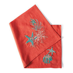 Frontgate - Set of Four Kim Seybert Sea Odyssey Napkins - Brings the beauty of a coral reef to a luxurious outdoor tabletop. Skilled artisans hand-sew individual beads, stones, and sequins onto the sturdy cotton backing of the runner. Sea Odyssey napkins are woven of the finest linen, then printed and embroidered with exceptionally detailed coral and starfish. Bias silk organza napkins have a delicate, lettuce-edge border. Coordinates with our Kim Seybert Capiz Shell Placemats and Coral Dinnerware, Drinkware, and Beaded candleholders. Serving dinner on the veranda or on a yacht, you will set the most magnificent table with the Sea Odyssey Collection. These stunning items from Kim Seybert celebrate the treasures of the sea with rich embroidery and sun-drenched colors.  . . .  . . Napkins are machine washable; for Bias Silk Napkins, machine wash gentle cycle, lay flat to dry; iron while damp avoiding lettuce edge border detail. Plates, glasses, and servers are not recommended for microwave use. Imported.