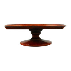 Pre-owned English Mahogany Turntable - A circa 1875 English mahogany turntable (lazy Susan). The table features a circular top above a turned base. This table will make a great centerpiece for any space, with its rich warm wood tones and quality craftsmanship, this antique piece will surely be passed on for many years to come.