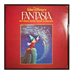"Glittered Fantasia Album - Glittered record album. Album is framed in a black 12x12"" square frame with front and back cover and clips holding the record in place on the back. Album covers are original vintage covers."