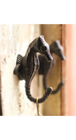 Cast Iron Seahorse Wall Hooks - Set of 2 - These cast iron seahorse wall hooks bring the ocean into your home naturally. Use it in your bathroom to hang towels or in the entryway for coats, bags, and even keys. The exquisite detailing also makes them a festive decorative accent that can adorn any wall in your home.