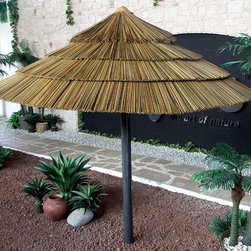 Thatch Umbrella - Synthetic - Synthetic thatch umbrellas are a beautiful canvas alternative that providesa tropical atmosphere paired with shade and comfort. Guaranteed to last for 15 years, synthetic thatch umbrellas are ideal for any weather condition..