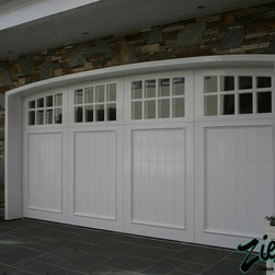 Traditional wood garage doors traditional style garage for Traditional american architecture