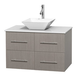 "Wyndham Collection - Centra 36"" Grey Oak SGL Vanity, White Stone Top, White Porcelain Sink, No Mrr - Simplicity and elegance combine in the perfect lines of the Centra vanity by the Wyndham Collection. If cutting-edge contemporary design is your style then the Centra vanity is for you - modern, chic and built to last a lifetime. Available with green glass, pure white man-made stone, ivory marble or white carrera marble counters, with stunning vessel or undermount sink(s) and matching Mrr(s). Featuring soft close door hinges, drawer glides, and meticulously finished with brushed chrome hardware. The attention to detail on this beautiful vanity is second to none."