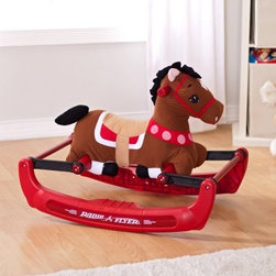 """Radio Flyer Soft Rock & Bounce Pony with Sound - Encourage exercise and imagination in your future cowboy or cowgirl with the Radio Flyer Soft Rock & Bounce Pony with Sound. This padded pony can be ridden with a smooth rocking action or a safe bouncing motion, and it makes realistic sounds to spur your child on to greater speeds. The base includes integrated steps for safe mounting and dismounting, and the handles are easy for little hands to grip. When your child grooms his horse, he'll love the crinkly ears and soft body. When it's time for you to help with the grooming, you'll love that this rocking horse is covered in removable, washable fabric. The patented rubber bounce system provides a quiet, safe ride, so you can delight in every giggle and """"Giddy-up."""" Requires 3 AA batteries (not included). Additional Features: Smooth rocking or safe bouncing actionBase with integrated steps for safe mountingWeight capacity: 45 pounds About Radio FlyerLike the Original Red Wagon that lent the company its name, Radio Flyer has become an American classic. From humble beginnings, Radio Flyer has been rediscovered with each new generation - creating a legacy of toys that continue to spark the imagination.For over 90 years, millions of children have played with Radio Flyer wagons, launching countless voyages of imagination. Their beauty, simplicity, and standards of safety encourage adventure, discovery, and the wonders of childhood. As the new millennium gains momentum, Radio Flyer is still in the driver's seat - creating tomorrow's innovative products with the same classic quality and sheer sense of play that have been their trademarks from the beginning."""