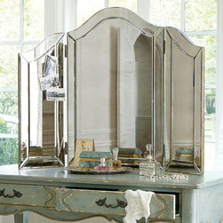 Brigitte Tri-Fold Mirror - The fairest of them all, Brigitte combines gothic Venetian influence with a large helping of Hollywood glamour. Chic atop a vanity, or your favorite dresser, the tri-fold design is framed with a double-mirrored border. Three smoked glass panels lend an antique appearance.