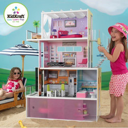 KidKraft - Beachfront Mansion - Get ready to fall in love with our Beachfront Mansion's sleek, modern design. This chic wooden dollhouse stands at over four feet tall and makes a great gift for any young girl who wants her dolls to live in style. Features: -Includes 14 pieces of furniture. -Made of composite wood. -Convenient storage space with two sliding doors located under the dollhouse. -Gliding elevator takes dolls from the first floor to the second.