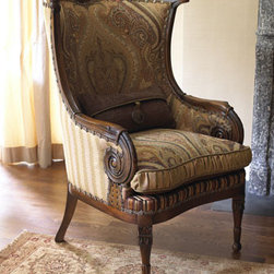 """""""Gretchen"""" Wingback Chair - The  """"Gretchen"""" Wingback Chair beautifully and uniquely combines a mix of classic paisley and tone-on-tone stripes with handsome leather.  Get years of wear from this gorgeous chair due to a seat cushion that's reversible from an aniline-dyed, hand-rubbed leather to a paisley pattern.  No details have been overlooked.  Even the nailhead is shaped in a Fleur-de-lis design.29""""W x 31""""D x 41""""T"""
