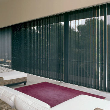 BlindSaver Basics Fabric Vertical Blinds - Combine the classic style of fabric verticals with the great pricing of BlindSaver! Available in a variety of colors, our Basics Fabric Vertical Blinds are a great choice for large windows and patio doors. The unique tracking system ensures even vane spacing and easy vane cleaning and replacement.