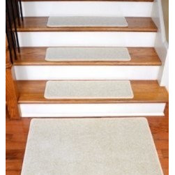 """Dean Flooring Company - Dean Carpet Stair Treads 27"""" x 9"""" Buff Ivory/Beige Plush (13) plus 2' x 3' Mat - Dean Carpet Stair Treads 27"""" x 9"""" Buff Ivory/Beige Plush (13) plus 2' x 3' Mat : Quality, Stylish Carpet Stair Treads by Dean Flooring Company. Extend the life of your high traffic hardwood stairs. Reduce slips/increase traction (treads must be properly secured to your stairs). Cut down on track-in dirt. Great for pets and pet owners (helps your dog easily navigate your slippery stairs. 100% Premium quality nylon. 35 ounce stain and spill resistant PLUSH carpeting. Dean signature rounded corners. Add a fresh new look to your staircase. Set includes 13 carpet stair treads PLUS one roll of double-sided carpet tape for easy, do-it-yourself installation and a matching 2' x 3' landing mat. Each tread is finished on the edges with color matching yarn. No bulky fastening strips. You may remove your treads for cleaning and re-attach them when you are done. Add a touch of warmth and style to your stairs today with new stair treads from Dean Flooring Company!"""