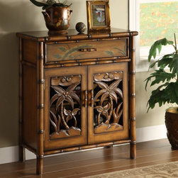 Coastal Style - This Polynesian-inspired cabinet is loaded with details. From the simulated bamboo frame, to the palm trees on the two doors allowing a peak at the adjustable shelf, all finished in Tupai Brown tone. The drawer is highlighted by hand painted tropical foliage and the drawer pulls continue the bamboo theme. Dimensions: 28x14x33 (ctc23054)