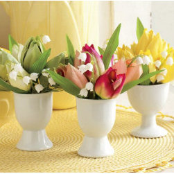 Potted Tulip Egg Cups - Egg cups make perfect little vessels for holding flowers. You can create a collection of vintage cups or choose a simple option like these white ones. They would be so cute on an Easter table as a centerpiece or even as a place setting marker.