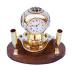Handcrafted Nautical Decor - Brass Diving Helmet Pen Holder - The Hampton Nautical Solid Brass Diving Helmet Pen Holder is a great desktop companion for any nautical enthusiast. The helmet features a working quartz clock. The diver helmet is a brass miniature of our bigger diver helmet.--The pen holder features two solid brass regular sized pen or pencil holders and rests nicely on a high quality solid hardwood base that has a polished finished. A green felt is placed on the bottom of the pen holder so it can rest on any surface without damage.--4ee Long x 3ee Wide x 3ee High----    Polished brass helmet body--    Twin pen holders for standard size pens and      pencils--    Fully functional clock keeps accurate time (batteries not included)--    Solid hardwood base rests firmly on a desk, table      or shelf--    Felt-lined footing protects furniture surfaces--