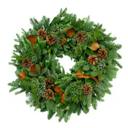 Magnolia Company - Signature Fresh Wreath, 18x18 - One of our favorites every year! This fresh and fragrant holiday wreath has a base of durable noble fir, copper backed Magnolia, blueberry cedar, and pinecones. This fragrant woodland wreath is featured throughout the Southern Living Idea House for 2013 in Nashville, TN.