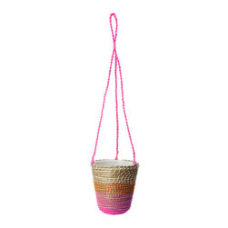 Jordnöt Planter - This hanging planter is a real eye-catcher. The woven structure with dashes of neon pink and orange sets the stage for a bit of green, and all you have to do is find a spot in your home for this beauty.