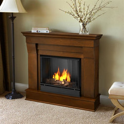 Real Flame - Chateau Ventless Gel Fireplace in Espresso - Includes: Mantel, firebox, hand painted cast concrete log, and screen kit. Solid wood and veneered MDF construction. Uses Only Real Flame 13oz Gel Fuel Cans, not included. Uses clean burning Real Flame Gel fuel emitting up to 9,000 BTUs of heat per hour lasting up to 3 hours. Assembly Required. 40.9 in. W x 11.8 in. D x 37.6 in. H (67.6 lbs.)The Chateau Fireplace features the clean lines and classic stylingfamiliar to stone mantels, realized in wood. In three great finishes, this design is sure to compliment a variety of decor, from classic to contemporary. The hand-painted log set and bright crackling flame add to the realistic look of this Real Flame Gel Fuel Fireplace. Uses 3 - 13oz. cans of Real Flame Gel Fuel.