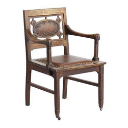 Wood and Leather Dining Chairs - Set of 6 - This woodsy dining chair would be pair perfectly with a long-leaf wooden table.  A wreath of carved leaves encircles the back while a cushioned leather upholstered seat provides comfort.  Exposed nail heads match brass castors on the front legs of each chair.