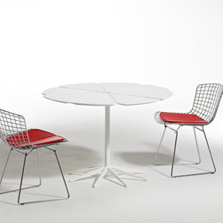Bertoia Side Chair - Harry Bertoia's delicately industrial Side Chair is among the most recognized achievements of mid-century modern design. Like Saarinen and Mies, Bertoia found sublime grace in an industrial material, elevating it beyond its normal utility into a work of art.