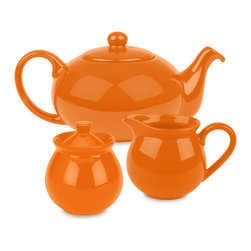 Waechtersbach - Fun Factory Tea Set, Orange - Brighten up your kitchen table with this Fun Factory Orange Tea Set. With its vibrant color and contemporary shape, this set will bring fun and joy into your home. Full tea service includes sugar bowl with lid, creamer, and tea pot with lid.