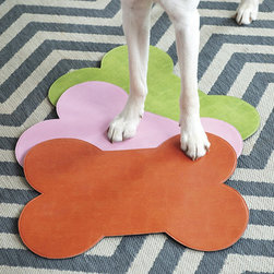 Ballard Designs - Bone Shaped Pet Bowl Mat - The dog food bowl and water dish in my house are kept in the kitchen next to the refrigerator. I keep a small mat underneath to keep the dish from moving and to catch small spills. I love these colorful bone-shaped mats from Ballard Designs. They would be a cute and colorful addition underneath your dog's food and water dishes.