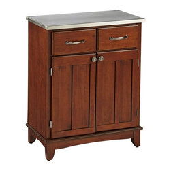 HomeStyles - Buffet in Cherry Finish - An irresistible combination in crafting for the dining room. Buffet cabinet in a classic design pairs with stainless steel to provide a modern-day work surface. Cherry finish adds the rich burnished hues that bring out the paneled detailing in the doors. * Two utility drawers. Two wood framed cabinet doors. Adjustable shelf. Brushed steel hardware. Equipped with adjustable floor levelers. Made from Asian hardwood. Made in Thailand. Assembly required. 29.25 in. W x 15.87 in. D x 36 in. HBuffet-of-buffets is an expansive collection of buffets designed to provide added storage and workspace for the kitchen and dining areas of the home. Including a clear coat finish to help protect against wear and tear from normal use.