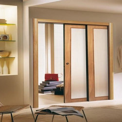 Sliding Doors - These wood and glass sliding bypass doors are beautiful and multifunctional. The frosted, tempered glass makes a grand statement in a simplistic way. Used to provide privacy and seclusion, they seamlessly integrate both rooms together.