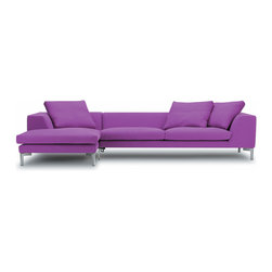 Orion sofa sectional - The large, slanting armrest combines design and function. Over and above their grandiose expression, they invite you to some comfy reading in a semi reclined position - well supported by the comfortable foam seat with down top. At the same time the distinctive armrest means that the sofa can cope with an elongated set-up without breaking up the visual impact.
