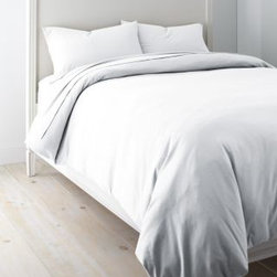 Garnet Hill - Garnet Hill Solid Jersey-Knit Crib Fitted Sheet - Crib - Fitted - White - This cozy combed-cotton jersey-knit bedding is knit of fine yarns for softness, and has a tighter construction than most for a smoother, more substantial feel. Dress your bed with the casual style and comfort of a favorite T-shirt. This higher-quality knit bedding looks great wash after wash, and won't twist on the mattress. A great year-round sheet. Clean double-stitched finish. Fitted sheet is fully elasticized for a better fit. 12-inch pocket depth.