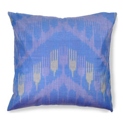 Ikat Pillows - To create the soft blues, browns, and yellows of this handmade Ikat pillow from the Ferghana Valley in Uzbekistan, 100% silk threads were hand-dyed with walnut skins, onion skins, and the indigo flower. 18 x 18 inches.