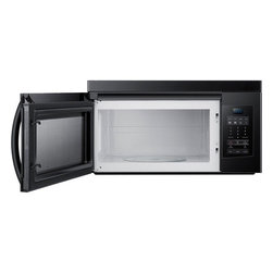"""Samsung - 1.6 Cu. Ft. 1000W Over-the-Range Microwave Oven - Description • Features • Specifications • Warranty •User Manual Description In the Range Microwave Oven, the automatic defrost and automatic reheat takes the guesswork out of defrosting and guarantees accuracy. The auto defrost feature considers the weight of the food being cook and adjusts the time accordingly. Two stage programmable cooking allows you to defrost food and program a 2 step recipe simultaneously, which make for more efficient food preparation. The electronic touch controls let you easily program the desired cooking time and power level, at the simple press of a button for error-free results every time. Back To Top Features Auto defrost and auto reheat options Electronic touch control Digital cooking time up to 99 minutes, 99 seconds Vent fan control: High / low / off Two-stage programmable cooking Four instant cook pads Child safety lock Back To Top Specifications  Product Specifications   UPC:  0-36725-57054-20-36725-57055-90-36725-57053-5   Product Type:  Microwave   Capacity:  1.6 Cu. Ft.   General Specifications   Cooking Power:  100 Watts   Ventilation System:  300 CFM   Power Levels:  10   Interior Light :  Incandescent  Dimensions   Height:  16.5""""   Width:  29.87""""   Depth:"""