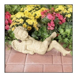 Ladybug - Resting Cherub Statue in Tea Stain Finish - Weather resistant finish. 1-Year warranty. Made in USA. Made of pecan shell resin. 19 in. W x 7 in. D x 8 in. H (8 lbs.)The finishes are applied by hand, enhancing every detail, and resulting in the uniqueness of no two pieces being exactly alike. Each individually hand-crafted piece of Ladybug product is cast in a crushed marble or resin composition which has the ability to capture and reproduce the same definition and minute detail as the original. It is a substantial, non-porous material which does not absorb moisture, making it ideal for outdoor use, although it offers the strength and durability required to endure even extreme weather conditions.
