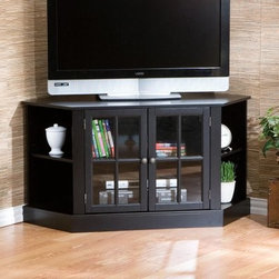 Thomas Black Corner Media Stand - An ideal addition to your living room or entertainment room, the Thomas Black Corner Media Stand is a perfect blend of style and functionality. It's constructed of Asian hardwoods, engineered wood, with veneer, Pewter hardware and polyresin for durability. One main center compartment, behind tempered glass paned doors, and additional side compartments offer ample storage space. Moreover, there's an adjustable shelf in the center area. The stand can hold up to 175 pounds of weight and can accommodate televisions up to 42 inches wide.